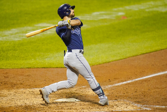 Tampa Bay Rays' Brandon Lowe follows through on a two-run home run during the eighth inning of a baseball game against the New York Mets Wednesday, Sept. 23, 2020, in New York. (AP Photo/Frank Franklin II)