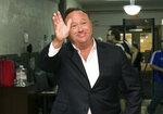 FILE - In this April 19, 2017, file photo, Alex Jones, a right-wing radio host and conspiracy theorist, arrives at the courthouse in Austin, Texas. YouTube, Facebook, Twitter, Spotify and other sites are finding themselves in a role they never wanted, as gatekeepers of discourse on their platforms,  deciding what should and shouldn't be allowed and often angering almost everyone in the process. The latest point of contention is Jones, who has suddenly found himself banned from most major platforms after years of being allowed to use them/. (Jay Janner/Austin American-Statesman via AP, File)