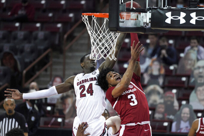 Arkansas guard Desi Sills (3) shoots as South Carolina forward Keyshawn Bryant (24) defends during the second half of an NCAA college basketball game Tuesday, March 2, 2021, in Columbia, S.C. (AP Photo/Sean Rayford)