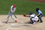 Philadelphia Phillies' Jay Bruce, left, hits a two-run home run during the sixth inning of a baseball game against the New York Mets at Citi Field, Sunday, July 7, 2019, in New York. (AP Photo/Seth Wenig)