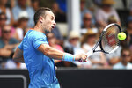 Philipp Kohlschreiber from Germany returns a shot against Tennys Sandgren from the U.S. during their semifinal match of the ASB Classic Mens tennis tournament in Auckland, New Zealand, Friday, Jan 11, 2019. (AP Photo/Chris Symes)
