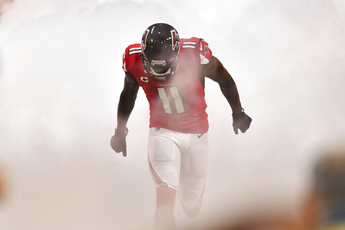 Atlanta Falcons wide receiver Julio Jones (11) enteres the fdield before the first half of an NFL football game against the Philadelphia Eagles, Sunday, Sept. 15, 2019, in Atlanta. (AP Photo/John Amis)