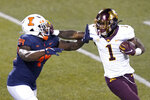 Minnesota running back Cam Wiley (1) stiff arms Illinois defensive lineman Owen Carney Jr. during the second half of an NCAA college football game Saturday, Nov. 7, 2020, in Champaign , Ill. Minnesota won 41-14. (AP Photo/Charles Rex Arbogast)