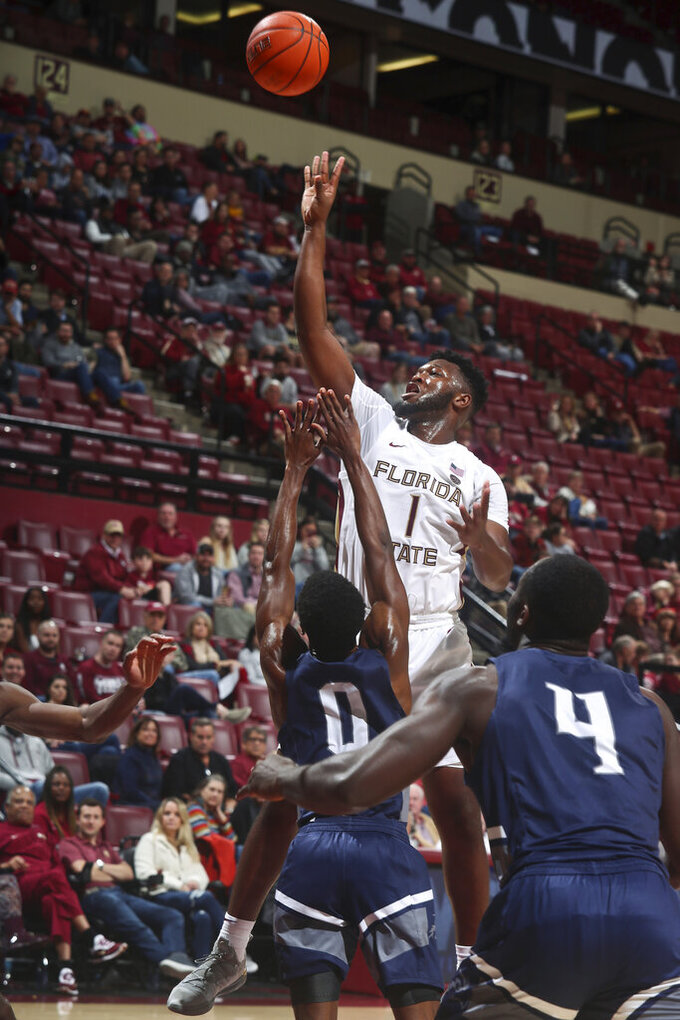 Florida State forward RaiQuan Gray (1) shoots as North Florida guard Emmanuel Adedoyin (0) defends in the second half of an NCAA college basketball game in Tallahassee, Fla., Tuesday, Dec. 17, 2019. Florida State won 98-81. (AP Photo/Phil Sears)