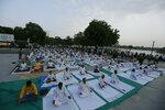 Indians performs Yoga on International Yoga Day at Kankariya lake in Ahmadabad, India, Friday, June 21, 2019. (AP Photo/Ajit Solanki)