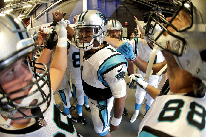 Carolina Panthers quarterback Cam Newton, center, gives a pep talk to his team before taking the field prior to an NFL football game against the Buffalo Bills, Thursday, Aug. 9, 2018, in Orchard Park, N.Y. (AP Photo/Julio Cortez)