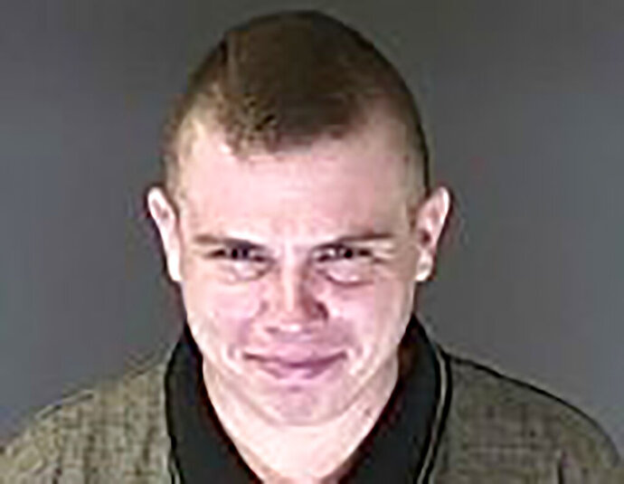 FILE - This file booking photo provided by the El Paso County Sheriff's Office shows Richard Holzer, who was arrested on Nov. 1, 2019. Holzer, an alleged white supremacist accused of plotting to bomb a historic Colorado synagogue, is due in federal court Monday, Nov. 25. (El Paso County Sheriff's Office via AP, File)