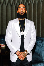 "This Jan. 16, 2019 photo released by Atlantic Records shows rapper Nipsey Hussle at The Peppermint Club in Los Angeles. Hussle, who was shot and killed outside of his clothing store in Los Angeles on March 31, 2019, is nominated for three Grammy Awards, His song ""Racks In the Midldle is up for best rap performance and best rap song, while ""Higher,"" a collaboration with DJ Khaled and John Legend that one of the last songs Hussle recorded, is nominated for best rap/sung performance. (Jennifer Johnson/Atlantic Records via AP)"