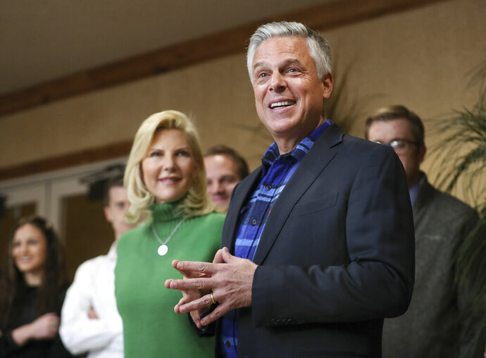 Jon Huntsman Jr. and his wife Mary Kaye talk with employees and clients at KKOS Lawyers and K&E CPAs in their offices in Cedar City, Utah, shortly after announcing that he is running for a third term as Utah's governor Thursday, Nov. 14, 2019. (Steve Griffin/The Deseret News via AP)