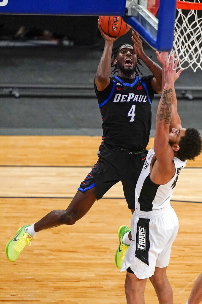 DePaul's Javon Freeman-Liberty (4) shoots over Providence's Jared Bynum (4) during the first half of an NCAA college basketball game in the Big East conference tournament Wednesday, March 10, 2021, in New York. DePaul won 70-62. (AP Photo/Frank Franklin II)
