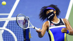 Naomi Osaka, of Japan, fires a ball into the stands after defeating Shelby Rogers, of the United States, during the quarterfinal round of the US Open tennis championships, Tuesday, Sept. 8, 2020, in New York. (AP Photo/Frank Franklin II)