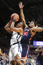 Butler guard Aaron Thompson (2) shoots in front of St. John's guard Nick Rutherford (24) in the first half of an NCAA college basketball game in Indianapolis, Wednesday, March 4, 2020. (AP Photo/Michael Conroy)