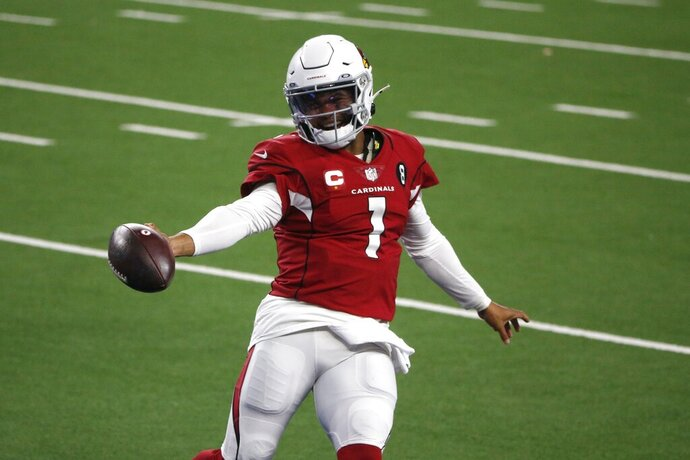 Arizona Cardinals' Kyler Murray celebrates running the ball for a touchdown in the second half of an NFL football game against the Dallas Cowboys in Arlington, Texas, Monday, Oct. 19, 2020. (AP Photo/Michael Ainsworth)