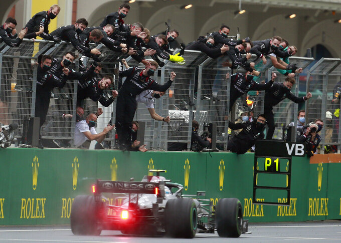 Mercedes driver Valtteri Bottas of Finland crosses the finish line to win the Turkish Formula One Grand Prix at the Intercity Istanbul Park circuit in Istanbul, Turkey, Sunday, Oct. 10, 2021. (AP Photo)