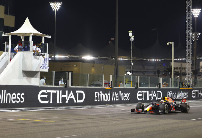 Red Bull driver Max Verstappen of the Netherlands wins the Formula One Abu Dhabi Grand Prix in Abu Dhabi, United Arab Emirates, Sunday, Dec. 13, 2020. (Giuseppe Cacace, Pool via AP)