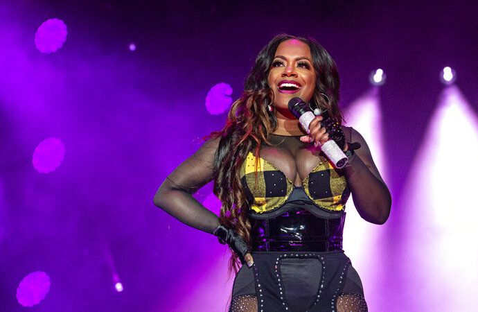 "FILE - In this July 7, 2018, file photo, Kandi Burruss of Xscape performs at the Essence Festival at the Superdome in New Orleans. Three people were shot and wounded Friday, Feb. 14, 2020, at a restaurant just outside Atlanta that's owned by singer and ""Real Housewives of Atlanta"" star Burruss. A man entered the Old Lady Gang restaurant and targeted another man, East Point (Ga.) police Capt. Allyn Glover told news outlets. Police say two bystanders were also shot, and all three shooting victims suffered non-life-threatening injuries. (Photo by Amy Harris/Invision/AP, File)"