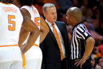 Tennessee head coach Rick Barnes speaks with officials during a timeout against Tennessee Tech in the second half of an NCAA college basketball game Saturday, Dec. 29, 2018, in Knoxville, Tenn.  (AP Photo/Shawn Millsaps)