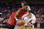 Maryland's Bruno Fernando (23) drives around Nebraska's Tanner Borchardt (20) during the first half of an NCAA college basketball game in Lincoln, Neb., Wednesday, Feb. 6, 2019. (AP Photo/Nati Harnik)