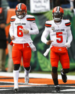 FILE - In this Nov. 25, 2018, file photo, Cleveland Browns quarterbacks Baker Mayfield (6) and Tyrod Taylor (5) warm up before an NFL football game against the Cincinnati Bengals in Cincinnati. When Cleveland fans fill FirstEnergy Stadium on Sunday for the first time in nearly two years, they'll see several familiar faces on Houston's roster, including Taylor, who was briefly the Browns' starter when Mayfield was a rookie in 2018.  (AP Photo/Gary Landers, File)