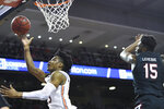 Auburn forward Isaac Okoro (23) scores two over South Carolina forward/center Wildens Leveque (15) during the second half of an NCAA college basketball game Wednesday, Jan. 22, 2020, in Auburn, Ala. (AP Photo/Julie Bennett)