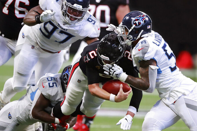 Atlanta Falcons quarterback Matt Ryan (2) is tackled by Tennessee Titans, from left to right, Jayon Brown, Isaiah Mack and Harold Landy III on a fourth down-attempt during the fourth quarter of an NFL football game Sunday, Sept. 29, 2019, in Atlanta. (Curtis Compton/Atlanta Journal-Constitution via AP)