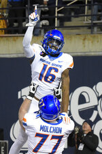 Boise State wide receiver John Hightower (16) celebrates with offensive lineman John Molchon (77) after scoring a touchdown against Utah State during the first half of an NCAA college football game Saturday, Nov. 23, 2019, in Logan, Utah. (AP Photo/Eli Lucero)