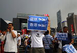 CORRECTS TRANSLATION - Pro-China supporters raises a placard reads
