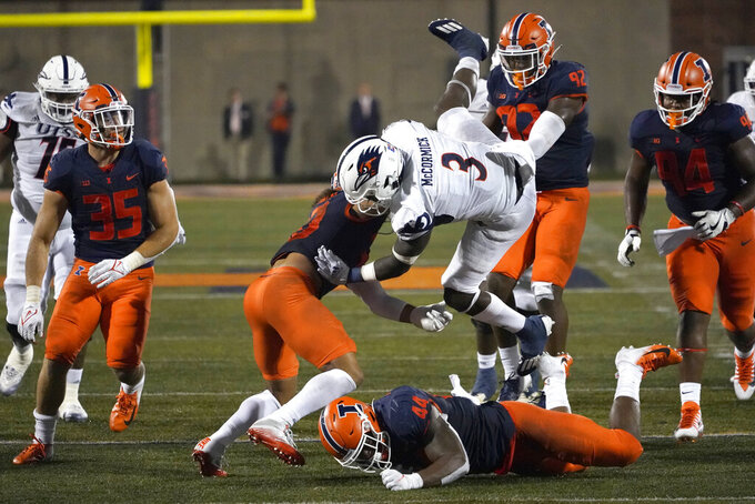 UTSA running back Sincere McCormick (3) is upended by Illinois defensive back Sydney Brown (30) during the first half of an NCAA college football game Saturday, Sept. 4, 2021, in Champaign, Ill. (AP Photo/Charles Rex Arbogast)
