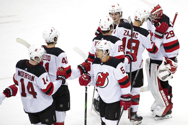 New Jersey Devils goaltender Mackenzie Blackwood (29) celebrates with teammates after their win an NHL hockey game against the New York Rangers, Saturday, March 7, 2020, at Madison Square Garden in New York. (AP Photo/Mary Altaffer)