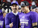Washington coach Chris Petersen, left, celebrates with defensive back Byron Murphy after Utah defeated Washington 10-3 in the Pac-12 Conference championship NCAA college football game in Santa Clara, Calif., Friday, Nov. 30, 2018. (AP Photo/Tony Avelar)