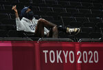 United States's men's team player Kevin Durant watches the women's basketball semifinal game between the United States and Serbia at the 2020 Summer Olympics, Friday, Aug. 6, 2021, in Saitama, Japan. (AP Photo/Eric Gay)