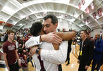 Colgate coach Matt Langel hugs guard Jordan Burns after the team's win against Bucknell in an NCAA college basketball game for the championship of the Patriot League men's tournament in Hamilton, N.Y., Wednesday, March 13, 2019. Colgate won 94-80. (AP Photo/Adrian Kraus)