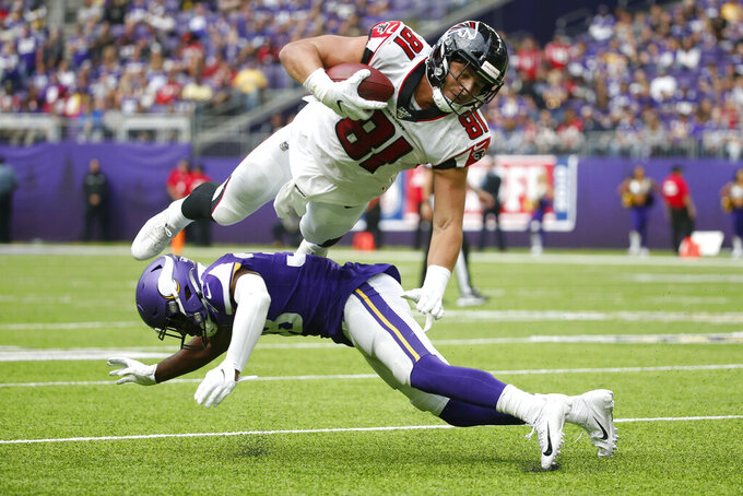 Atlanta Falcons tight end Austin Hooper (81) is tackled by Minnesota Vikings defensive back Kris Boyd after making a reception during the second half of an NFL football game, Sunday, Sept. 8, 2019, in Minneapolis. (AP Photo/Bruce Kluckhohn)