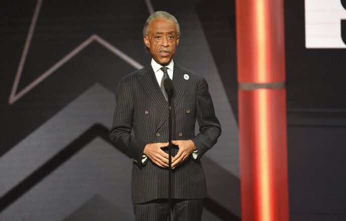 "FILE - This June 23, 2019 file photo shows Al Sharpton presenting an award at the BET Awards in Los Angeles. Sharpton is working on a book meant to address what he calls an urgent moment in American history. Hanover Square Press announced Monday that the longtime civil rights activist's ""Rise Up: Confronting a Country at the Crossroads"" is coming out Sept. 15.(Photo by Chris Pizzello/Invision/AP, File)"