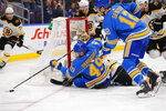 St. Louis Blues' Ivan Barbashev (49), of Russia, attempts to pass the puck after a shot on goal against the Boston Bruins during the second period of an NHL hockey game Saturday, Feb. 23, 2019, in St. Louis. (AP Photo/Dilip Vishwanat)