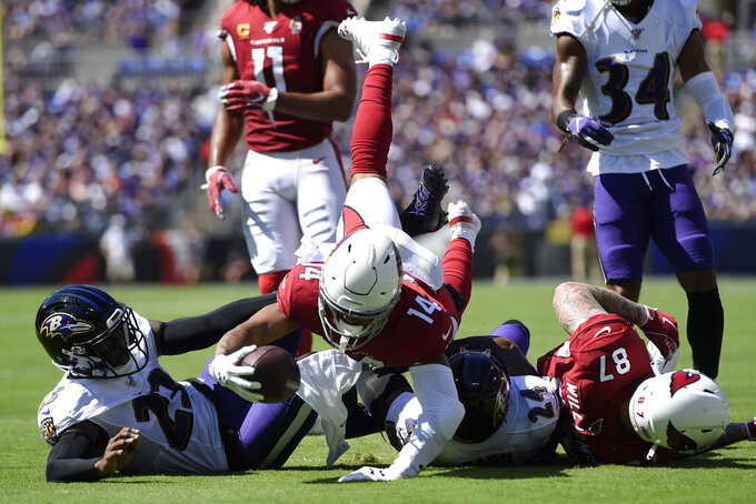 Arizona Cardinals wide receiver Damiere Byrd (14) dives as he rushes the ball in the first half of an NFL football game against the Baltimore Ravens, Sunday, Sept. 15, 2019, in Baltimore. (AP Photo/Gail Burton)