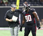 Atlanta Falcons head coach Arthur Smith gives defensive lineman Marlon Davidson a pat on the helmet to encourage the defense during a first half time out against the Cleveland Browns in an NFL preseason football game on Sunday, Aug. 29, 2021, in Atlanta. (Curtis Compton/Atlanta Journal-Constitution via AP)