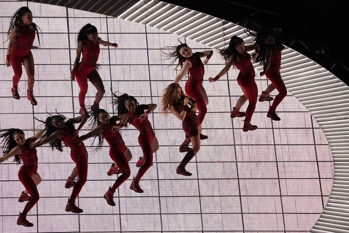 Singer Shakira, center, performs, during the halftime show of the NFL Super Bowl 54 football game between the San Francisco 49ers and Kansas City Chiefs', Sunday, Feb. 2, 2020, in Miami Gardens, Fla. (AP Photo/Morry Gash)