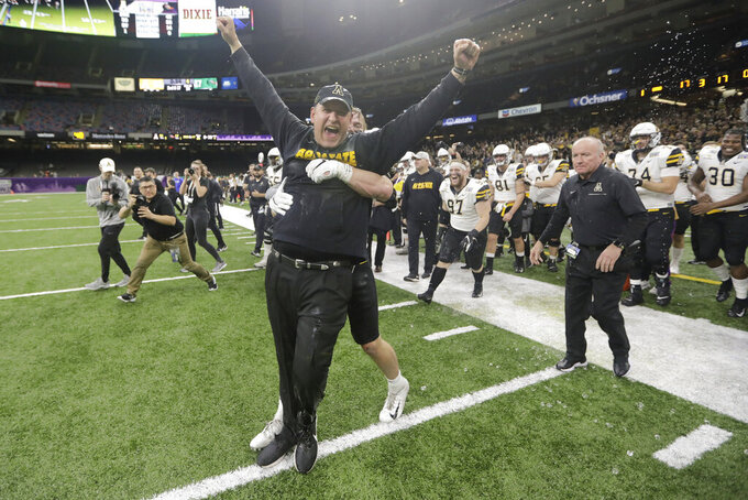 Appalachian State coach Shawn Clark celebrates the team's win over UAB in the New Orleans Bowl NCAA college football game in New Orleans, Saturday, Dec. 21, 2019. Appalachian State won 31-17. (AP Photo/Brett Duke)