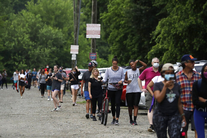 People wait in line to vote in the Georgia's primary election at Park Tavern on Tuesday, June 9, 2020, in Atlanta. (AP Photo/Brynn Anderson)