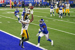 Pittsburgh Steelers wide receiver JuJu Smith-Schuster (19) comes down with a touchdown pass against New York Giants cornerback James Bradberry (24) during the fourth quarter of an NFL football game Monday, Sept. 14, 2020, in East Rutherford, N.J. (AP Photo/Seth Wenig)