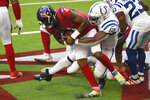 Houston Texans quarterback Deshaun Watson (4) is sacked by Indianapolis Colts defensive end Justin Houston (50) for a safety during the second half of an NFL football game Sunday, Dec. 6, 2020, in Houston. (AP Photo/Eric Christian Smith)