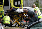 Ambulance staff take a man from outside a mosque in central Christchurch, New Zealand, Friday, March 15, 2019.  Multiple people were killed in mass shootings at two mosques full of worshippers attending Friday prayers on what the prime minister called