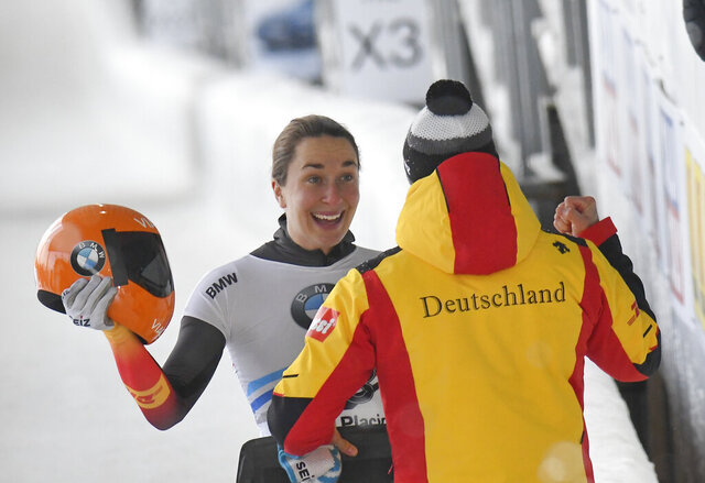 Jacqueline Loelling, of Germany, celebrates her first place finish after the second run of the women's World Cup skeleton opener in Lake Placid, N.Y., on Saturday, Dec. 7, 2019. (AP Photo/Hans Pennink)