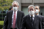 Former Nissan Motor Co. executive Greg Kelly, left, arrives for the first trial hearing at the Tokyo District Court in Tokyo Tuesday, Sept. 15, 2020. The financial misconduct trial of Kelly opened Tuesday. Japanese prosecutors outlined allegations of what they said was a complex and clandestine scheme to pay former star executive Carlos Ghosn. (Kiyoshi Ota/Pool Photo via AP)