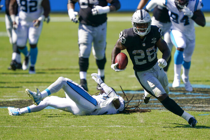 Las Vegas Raiders running back Josh Jacobs runs against the Carolina Panthers during the second half of an NFL football game Sunday, Sept. 13, 2020, in Charlotte, N.C. (AP Photo/Brian Blanco)