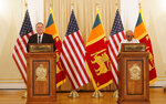 U.S. Secretary of State Mike Pompeo and Sri Lankan Foreign Minister Dinesh Gunawardena attend a joint press briefing in Colombo, Sri Lanka, Wednesday, Oct. 28, 2020. Pompeo plans to press Sri Lanka to push back against Chinese assertiveness, which U.S. officials complain is highlighted by predatory lending and development projects that benefit China more than the presumed recipients. The Chinese Embassy in Sri Lanka denounced Pompeo's visit to the island even before he arrived there, denouncing a senior U.S. official's warning that the country should be wary of Chinese investment. (AP Photo/Eranga Jayawardena)