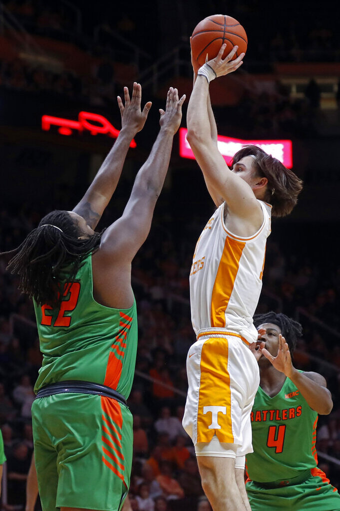 Tennessee forward John Fulkerson (10) shoots over Florida A&M center Evins Desir (22) during the first half of an NCAA college basketball game Wednesday, Dec. 4, 2019, in Knoxville, Tenn. (AP Photo/Wade Payne)