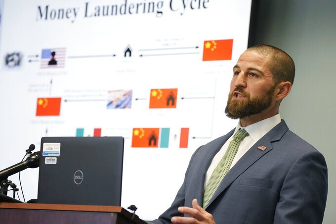 Steve Cagen, special agent in charge of Homeland Security Investigations, makes a point during a news conference Thursday, June 10, 2021,in Centennial, Colo. Three agencies—Homeland Security, the office of the district attorney in the 18th Judicial District of Colorado and the Drug Enforcement Administration—held the news conference to explain the major grand jury indictments issued in a money-laundering scheme involving the distribution of drugs by major cartels and how the money earned was then laundered through contacts in China. (AP Photo/David Zalubowski)