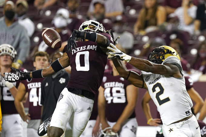 Texas A&M's Myles Jones (0) breaks up a pass intended for Vanderbilt's Amir Abdur-Rahman (2) during the second half of an NCAA college football game Saturday, Sept. 26, 2020, in College Station, Texas. Texas A&M won 17-12. (AP Photo/David J. Phillip)
